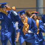 Justin Sheely | The Sheridan Press Culley Emborg, left, and Matthew Eisenhauer battle the wind as their march across Homer Scott Field during the 2017 graduation ceremony Saturday at Sherida ...
