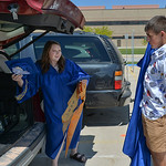 Justin Sheely | The Sheridan Press Tayci Maxwell and Derek Vela put on their garments in the parking lot prior to the 2017 graduation ceremony Saturday at Sheridan High School.