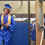 Justin Sheely | The Sheridan Press Bryson Miranda waits on his phone prior to the 2017 graduation ceremony Saturday at Sheridan High School.