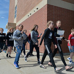 Justin Sheely | The Sheridan Press Middle school students walk to the front doors of the building to return to class during the organized walkout at Sheridan Junior High School Friday, April ...