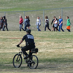 Justin Sheely | The Sheridan Press School resource officer Howie Fitzpatrick moves on his bicycle during the organized walkout at Sheridan Junior High School Friday, April 20, 2018. More tha ...