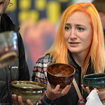 "Justin Sheely | The Sheridan Press Erin Kensey is faced with a dilemma as she tries to choose her favorite bowl during the ""Filling and Empty Bowl"" VOA soup fundraiser at the Sheridan Co ..."