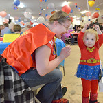 "Justin Sheely | The Sheridan Press Sara Haight and her daughter Miranda Haight, 2, dressed as Wonder Woman for the ""Souper Hero"" theme this year during the ""Filling and Empty Bowl"" V ..."
