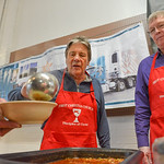 "Justin Sheely | The Sheridan Press Ron Kensey, left, and Doug Goodwin serve a guest during the ""Filling and Empty Bowl"" VOA soup fundraiser at the Sheridan County Fairgrounds Exhibit Hal ..."