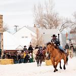 Matthew Gaston | The Sheridan PressRider Nick McDonald and skier Jeff Stull race out of the starting gate at the Sheridan WYO Winter Rodeo Saturday, Feb. 23, 2019.