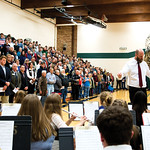 "Matthew Gaston | The Sheridan PressThe crowd rises to their feet as the band, led by Jason McArthur plays ""After the Battle,"" during the Veterans Day Assembly at Tongue River Middle Scho ..."