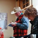 Matthew Gaston | The Sheridan PressNew York Times best selling author Craig Johnson autographs copies of his books at the Ucross Community Christmas Celebration Saturday, Dec. 15, 2018.