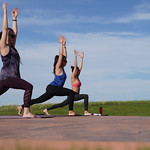 Matthew Gaston | The Sheridan PressYoga practitioners, from left, Cassie Jaeb, Monica Riesch and Lauren Nieves reach towards the heavens in the warrior 1 pose during Yoga at The Brinton host ...
