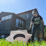Justin Sheely | The Sheridan Press Antelope Butte Foundation board member Josh Law tosses scraps into a pile for the workday day Saturday at Antelope Butte ski area in the Bighorn mountains. ...