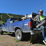 Justin Sheely | The Sheridan Press James Andrews sits on the back of a truck loaded with scrap metal for the workday day Saturday at Antelope Butte ski area in the Bighorn mountains. Dozens  ...