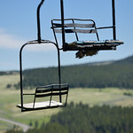 Justin Sheely | The Sheridan Press Weathered lift benches hang in the air Saturday at Antelope Butte ski area in the Bighorn mountains.