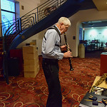 "Justin Sheely | The Sheridan Press Musician Gary McKnight tests the response of the reed in his clarinet in the lobby during a full dress rehearsal for the WYO Theater Gala: ""Lend Me a Ten ..."