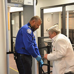 Justin Sheely | The Sheridan Press A TSA Officer helps Pearl Harbor Survivor Mel Heckman through the security checkpoint at the Sheridan County Airport Malcolm Wallop Terminal Thursday morni ...