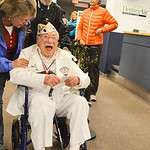 Justin Sheely | The Sheridan Press Pearl Harbor Survivor Mel Heckman laughs as friendly words are exchanged at the Sheridan County Airport Malcolm Wallop Terminal Thursday morning on his fli ...