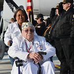 Justin Sheely | The Sheridan Press Charlene Bassett pushes Pearl Harbor survivor Mel Heckman past the honor guard assembled on the tarmac after returning from their visit to Honolulu, Hawaii ...