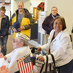 Justin Sheely | The Sheridan Press Charlene Bassett pushes Pearl Harbor survivor Mel Heckman through the terminal as veterans, friends and community members welcome them at the Sheridan Coun ...