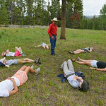 Justin Sheely | The Sheridan Press Game Warden Bruce Scigliano instructs the group as they lay in a circle with their eyes closed during an outing with Wyoming Wilderness' Young Ambassador ...
