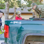 Ashleigh Fox | The Sheridan Press Sheridan Police Department Officer Rodney Swaney and Wyoming Game and Fish Department wardens Craig Smith and Dustin Shorma load the tranquilized black bear ...