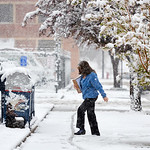 Justin Sheely | The Sheridan Press A woman walks across slushy snow at the post office Tuesday morning in Sheridan. The National Weather Service predicts 3-6 inches of heavy snow in the area ...
