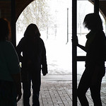 Justin Sheely | The Sheridan Press Library staff open the sliding doors for a visitor during a power outage Tuesday morning at the Sheridan County Fulmer Public Library. Much of downtown She ...