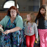 Justin Sheely | The Sheridan Press Children's Librarian Michelle Havenga reads a book at Kelly Tuttle and Amelia Martin, 5, during a power outage Tuesday morning at the Sheridan County Ful ...