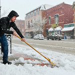 Justin Sheely | The Sheridan Press Jeff Garrelts, co-owner of the Cottonwood Shop, removes slushy snow from the sidewalk Tuesday morning on Sheridan's Main Street. The National Weather Ser ...