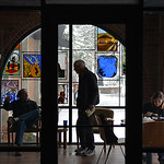 Justin Sheely | The Sheridan Press People visit in the coffee room where there is daylight during a power outage Tuesday morning at the Sheridan County Fulmer Public Library. Much of downtow ...