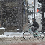 Justin Sheely | The Sheridan Press A bicyclist rides through the slush Tuesday morning along Sheridan's Main Street. Much of downtown Sheridan was without power for about an hour during Tu ...