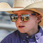 Justin Sheely | The Sheridan Press Nine-year-old Tate Leno helps with sorting the steers behind the chute during the Sheridan High School Rodeo at the Sheridan County Fairgrounds Saturday, M ...