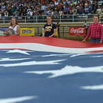 Justin Sheely | The Sheridan Press Volunteers hold the national flag during the Sheridan WYO Rodeo at the Sheridan County Fairgrounds Saturday, July 14, 2018.