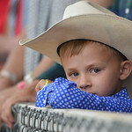 Justin Sheely | The Sheridan Press Five-year-old holden Esch of Cheyenne looks on with his grandparents during the Sheridan WYO Rodeo at the Sheridan County Fairgrounds Saturday, July 14, 20 ...