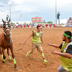 Bud Denega | The Sheridan PressJoey Guteirrez, jockey for Mountain Crow from Pryor, Montana, rushes to his next pony during the World Champion Indian Relay race Saturday, July 13, 2019.