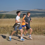 Bud Denega | The Sheridan Press Alex Garber, left, Garett Avery, middle and David Standish warm-up during the Sheridan High School cross-country mountain camp at 4-H Campground near Burgess  ...