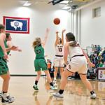 Matthew Gaston | The Sheridan PressBig Horn's Madison Butler (13) shoots the 3-pointer over Moorcroft's Lizzie Peterson Friday, Jan. 24, 2020.