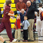 Tibby McDowell | The Sheridan Press  Jacob Alley, left, and Max Alley, center, help dad and head coach Ryan Alley, right, with high fives before the game at Big Horn High School Friday Feb 2 ...