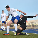 Justin Sheely | The Sheridan Press Sheridan's Sam Smart, left, passes the ball against Cheyenne South's Zeuss Jimenez at Homer Scott Field Friday, March 23, 2018. The Broncs fell 3-1.