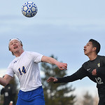 Justin Sheely | The Sheridan Press Sheridan's Chance Quarterman (14) takes a header over Cheyenne South's Pablo Sanchez at Homer Scott Field Friday, March 23, 2018. The Broncs fell 3-1.