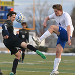 Justin Sheely | The Sheridan Press Sheridan's Tristan Bower, right, battles for the ball against Cheyenne South's Brian Gonzalez at Homer Scott Field Friday, March 23, 2018. The Broncs f ...