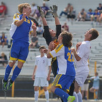 Justin Sheely | The Sheridan Press Sheridan Bronc players Dalton Legerski, left, and Brice Beisher content for the ball over Laramie's goalkeeper during the 4A East semifinal regional tour ...