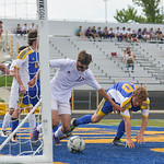 Justin Sheely | The Sheridan Press Broncs' Dalton Legerski and Plainsman Kyle Reynolds fight for the ball after a kick at the Laramie net during the 4A East semifinal regional tournament F ...