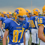 Justin Sheely | The Sheridan Press Trent Taylor walks along the sideline during the season opener against Laramie Friday night on Scott Field at Sheridan High School. The Broncs dominated th ...