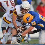 Justin Sheely | The Sheridan Press Sheridan's Connor Jorgenson, right, tries to take the ball as Plainsman Garrett Worden recovers the fumble during the season opener against Laramie Frida ...