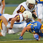 Justin Sheely | The Sheridan Press Sheridan's Parker Christensen goes down with Plainsman Baxter Tuggle on top during the season opener against Laramie Friday night on Scott Field at Sheri ...