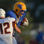Justin Sheely | The Sheridan Press Sheridan's Aaron Woodward pushes on during the season opener against Laramie Friday night on Scott Field at Sheridan High School. The Broncs dominated th ...