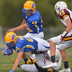 Justin Sheely | The Sheridan Press Parker Christensen goes down during the season opener against Laramie Friday night on Scott Field at Sheridan High School. The Broncs dominated the Plainsm ...