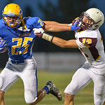 Justin Sheely | The Sheridan Press Sheridan's Parker Christensen stiff-arms Plainsman Connor Beeston during the season opener against Laramie Friday night on Scott Field at Sheridan High S ...