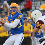Justin Sheely | The Sheridan Press Broncs' quarterback Drew Boedecker looks for an opening during the season opener against Laramie Friday night on Scott Field at Sheridan High School. The ...
