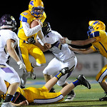 Justin Sheely | The Sheridan Press Broncs' quarterback Drew Boedecker is sacked for the second time during the rivalry game against Gillette Friday night at Scott Field in Sheridan. The Br ...