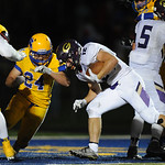 Justin Sheely | The Sheridan Press Broncs' Kyle Custis closes in on Camels' Austin Clemetson during the rivalry game against Gillette Friday night at Scott Field in Sheridan. Turnovers p ...