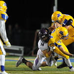 Justin Sheely | The Sheridan Press Broncs' Kyle Custis is brought down during the rivalry game against Gillette Friday night at Scott Field in Sheridan. Turnovers plagued the Broncs, Camel ...